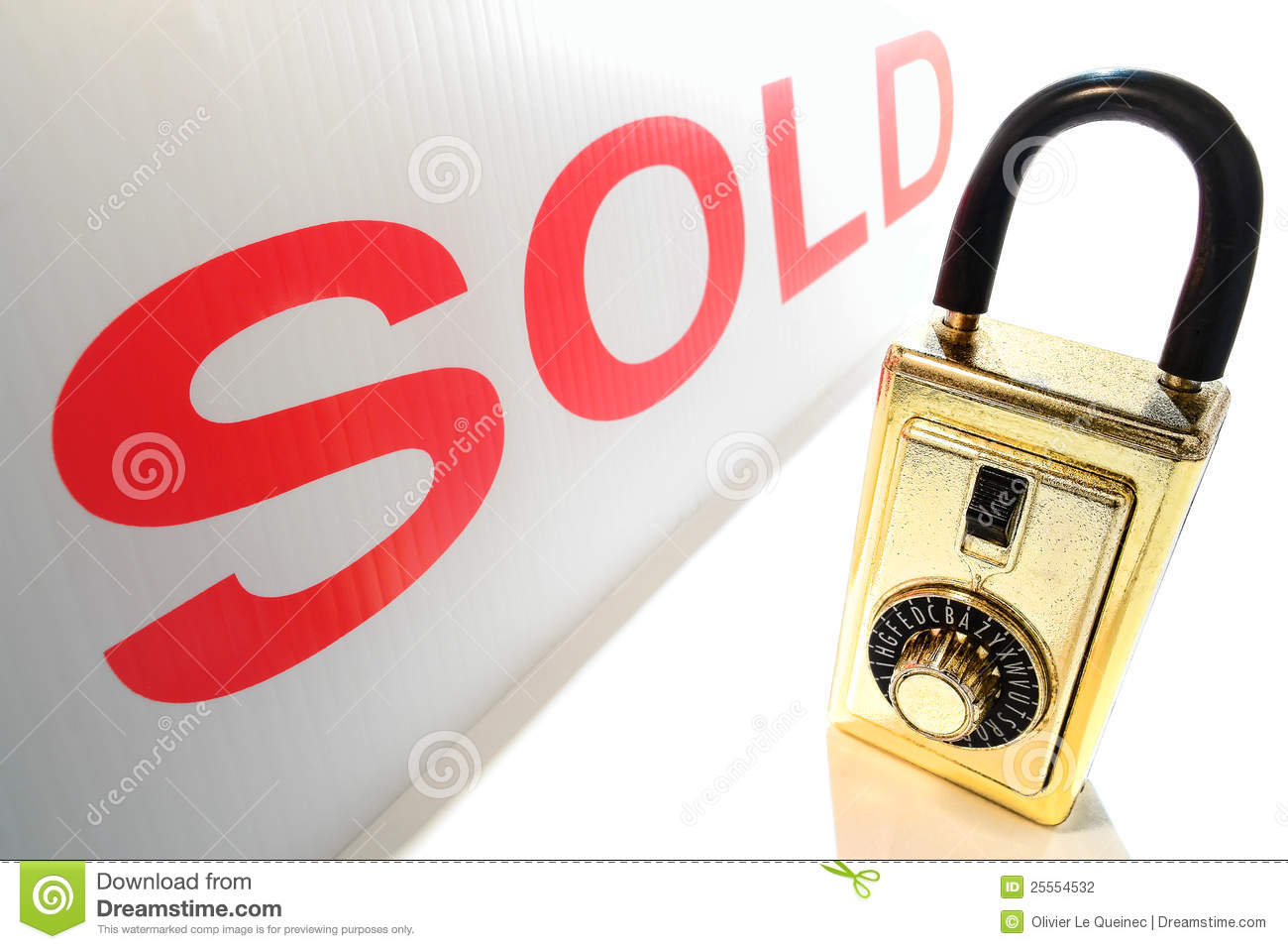 Real Estate Realtor Key Lock Box And Red Sold Sign Stock