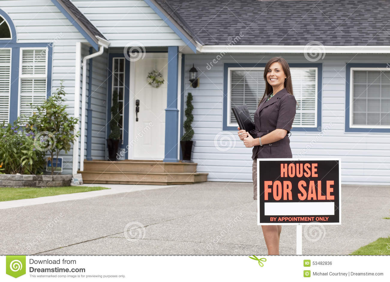 Real estate agent standing outside house stock photography for Real time pictures of my house