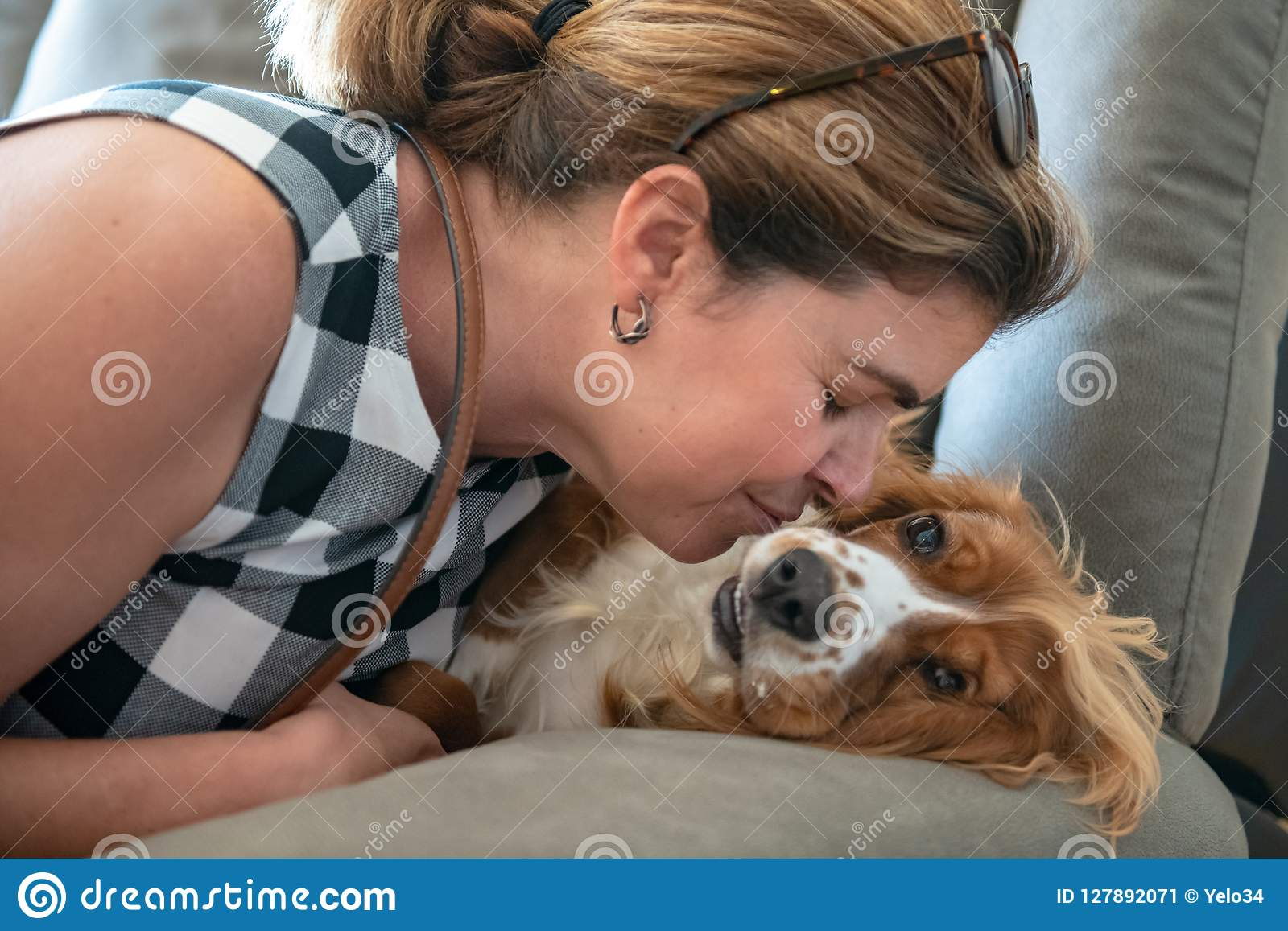 Real woman people playing with cocker spaniel dog