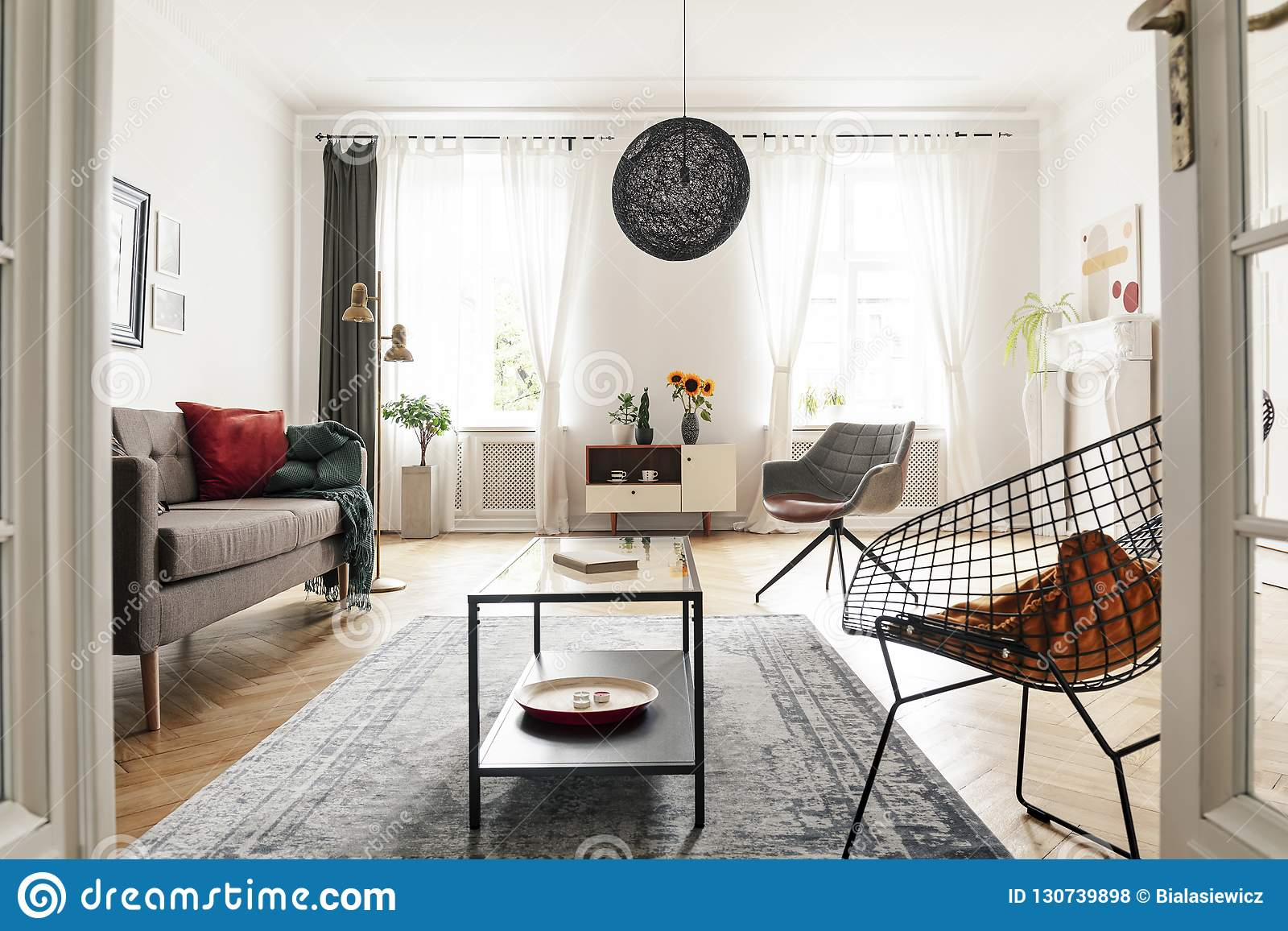 Bright Living Room Interior With A Metal Armchair Coffee Table