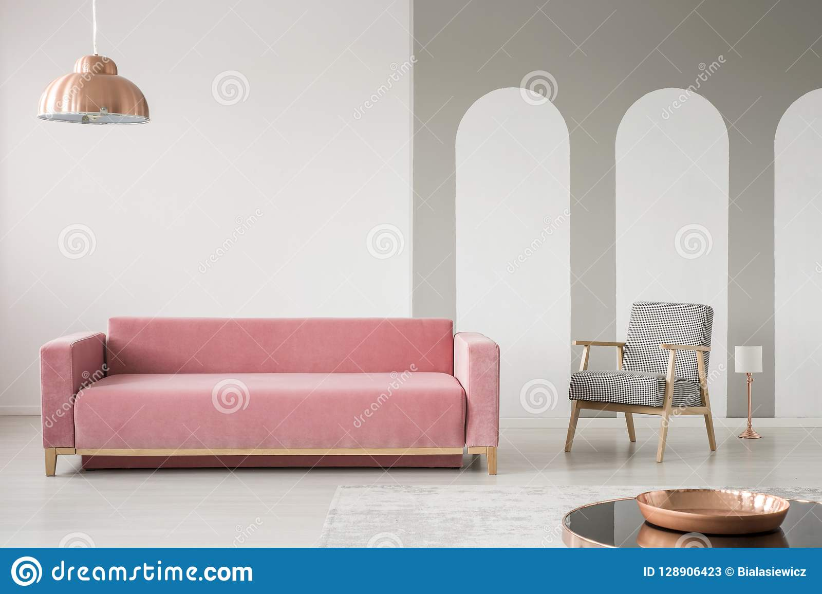 Creative Living Room Interior Decorated With Arches Pink Sofa And