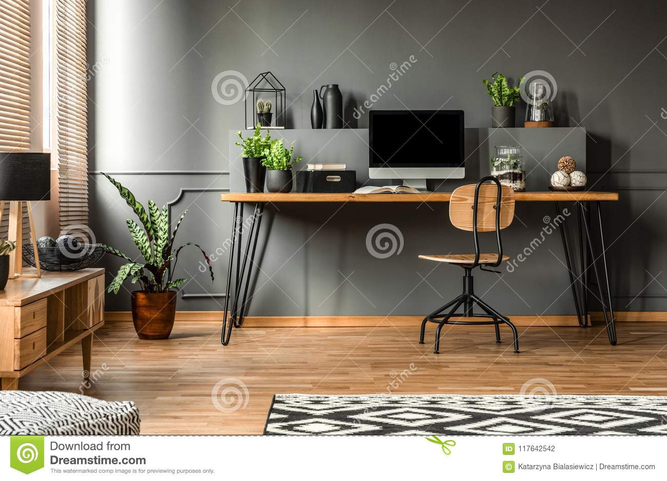 Real Photo Of A Dark Interior With Wooden Desk Chair And