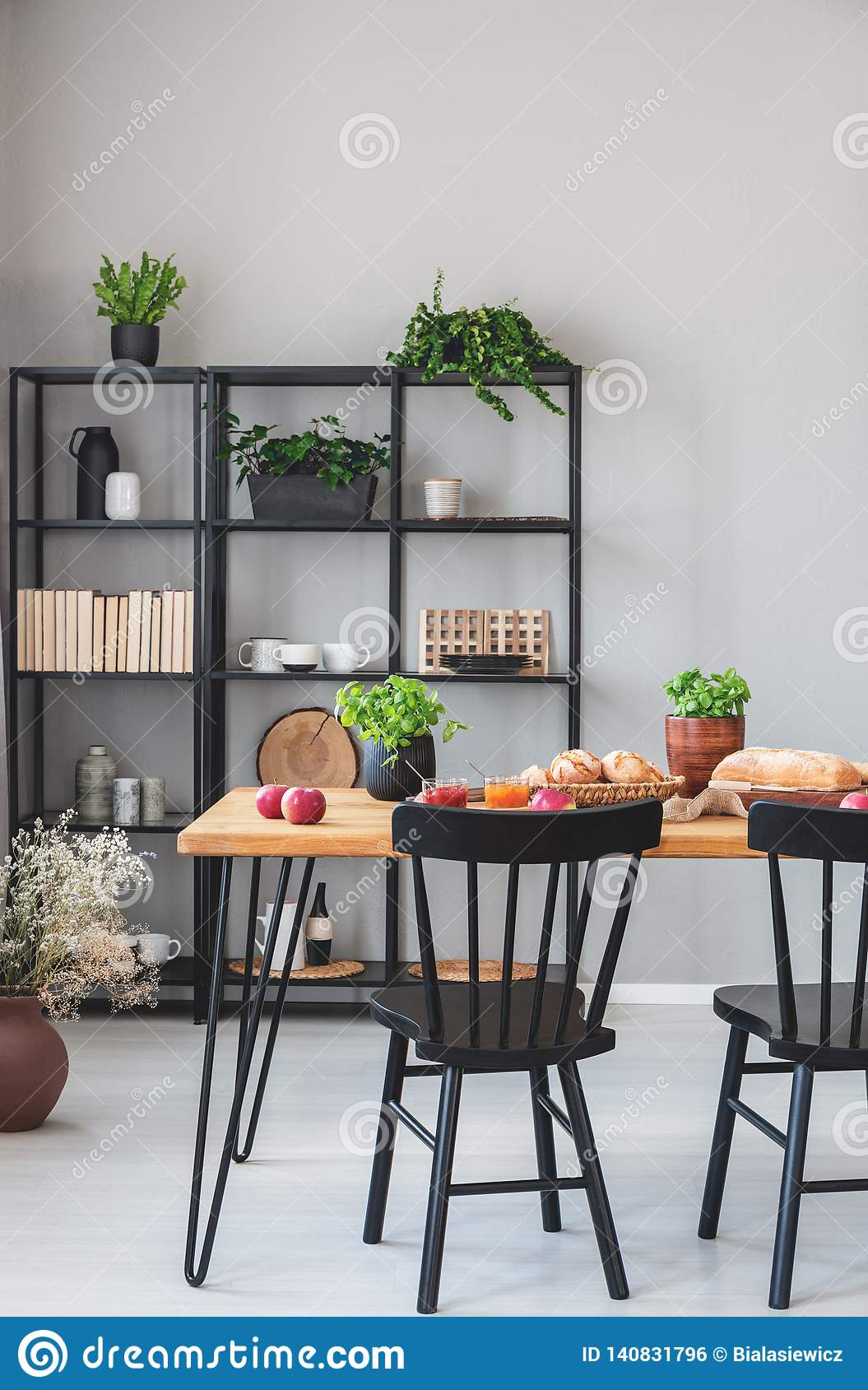 Real Photo Of A Grey Dining Room Interior With Metal Shelves ...