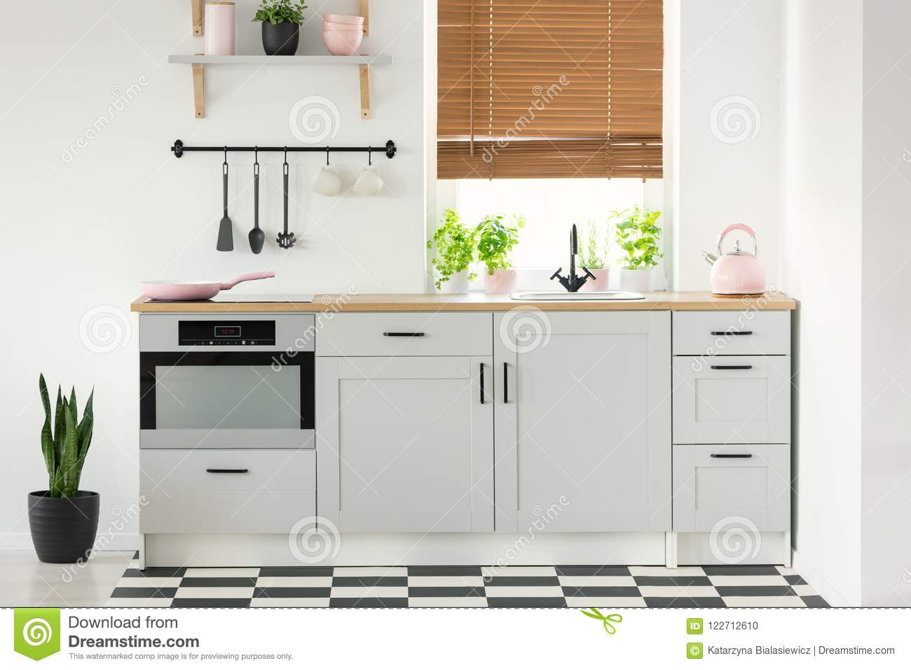 Real Photo Of A Kitchen Interior With White Cupboards Pink