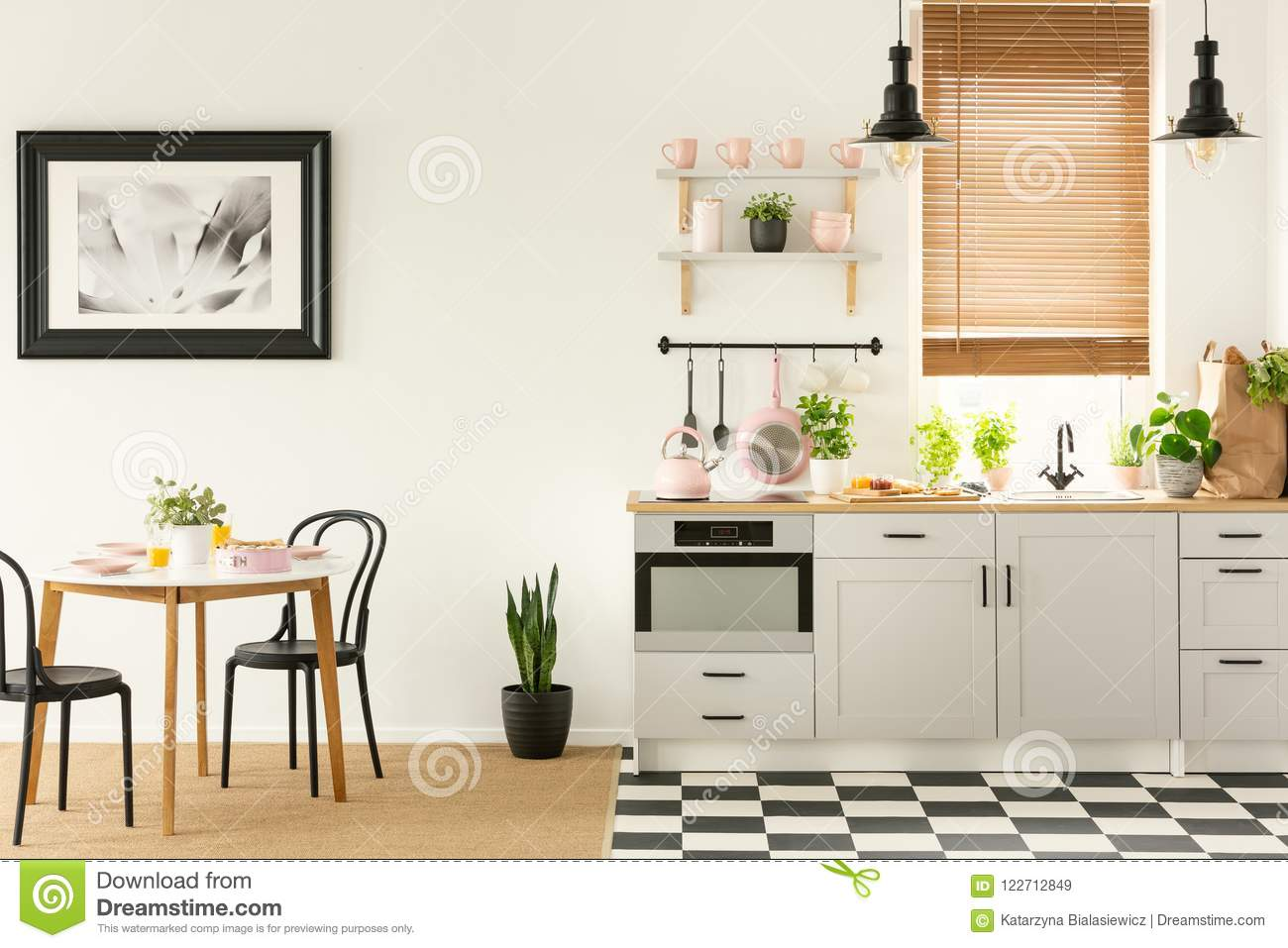 Real Photo Of An Open Space Kitchen And Dining Room With Black A