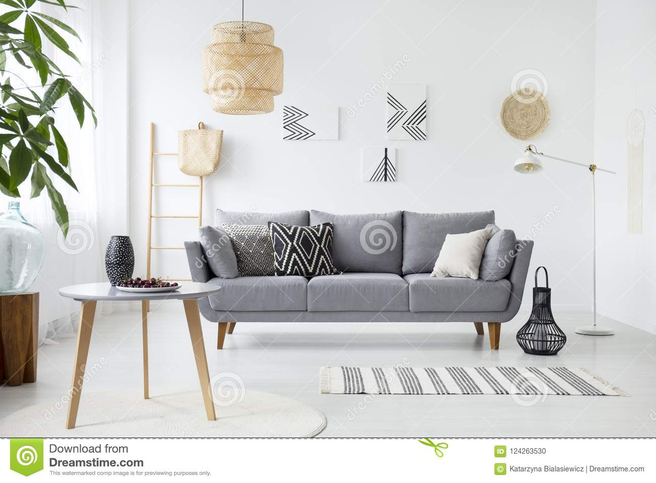 Real Photo Of A Simple Living Room Interior With Cushions On Gray