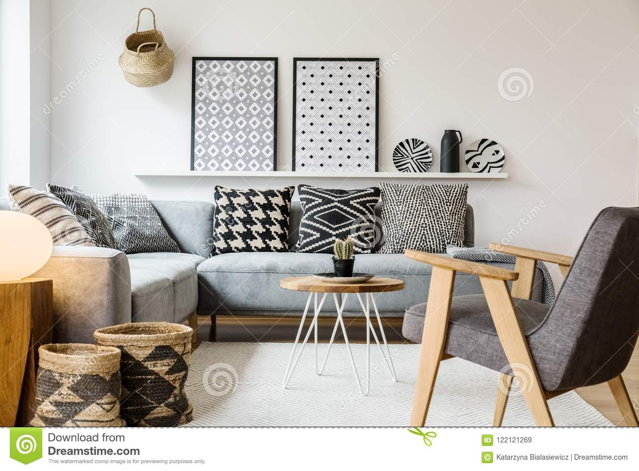 Swell Real Photo Of A Small Table Standing Between A Sofa With Gmtry Best Dining Table And Chair Ideas Images Gmtryco
