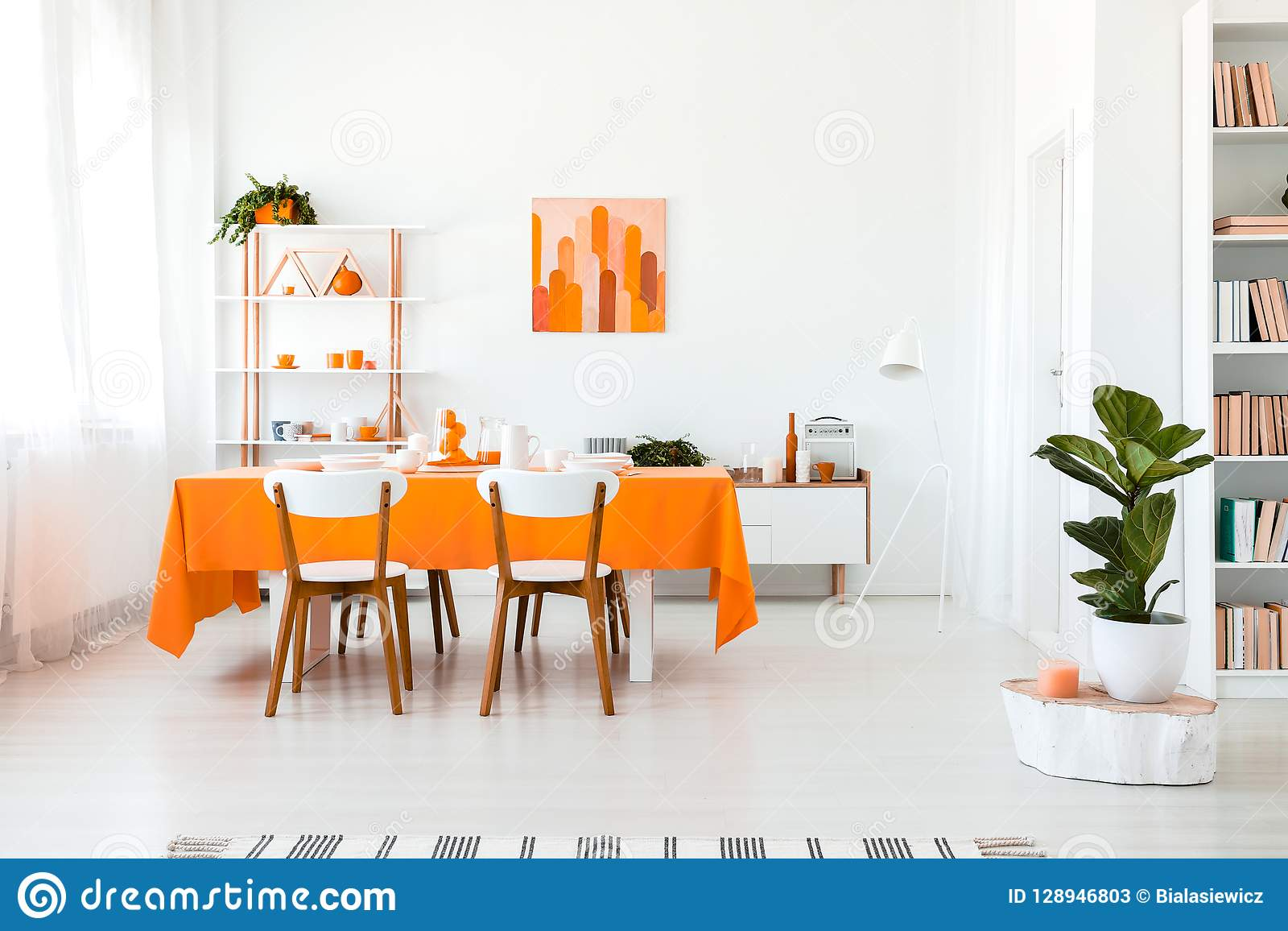 Stylish But Simple Dining Room In Vivid Color Orange And White Interior Design Concept Stock Image Image Of Cabinet Chairs 128946803