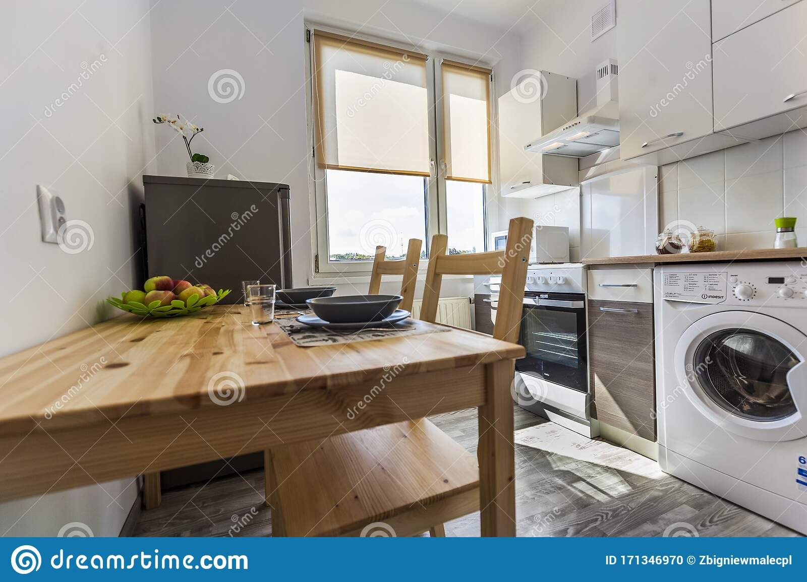 Real And Special Small Kitchen Equipped With A Table Chairs Fridge And Washing Machine Editorial Image Image Of Dining Friendly 171346970