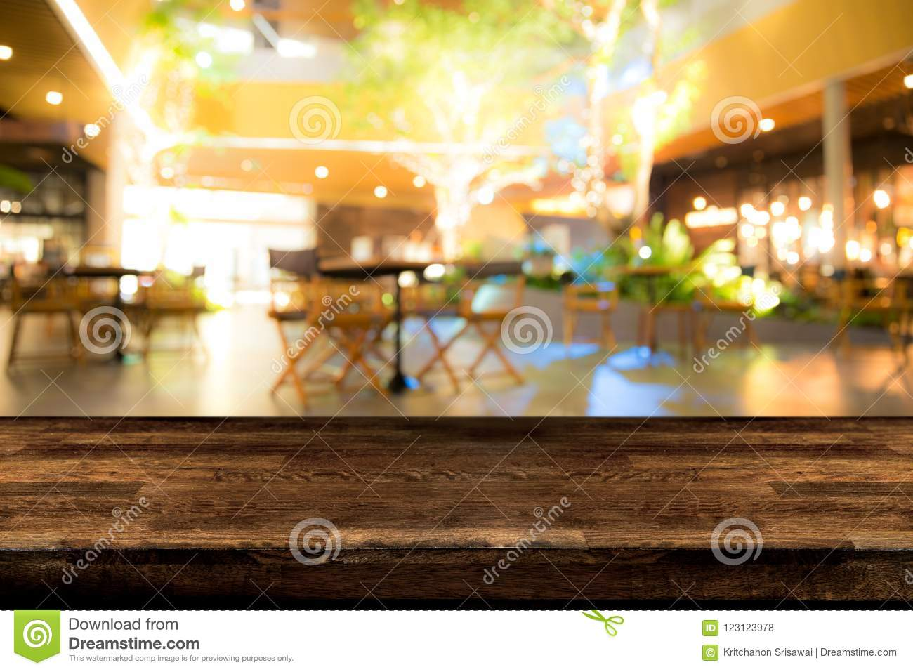 Real wood table with appetizer and light reflection on scene at
