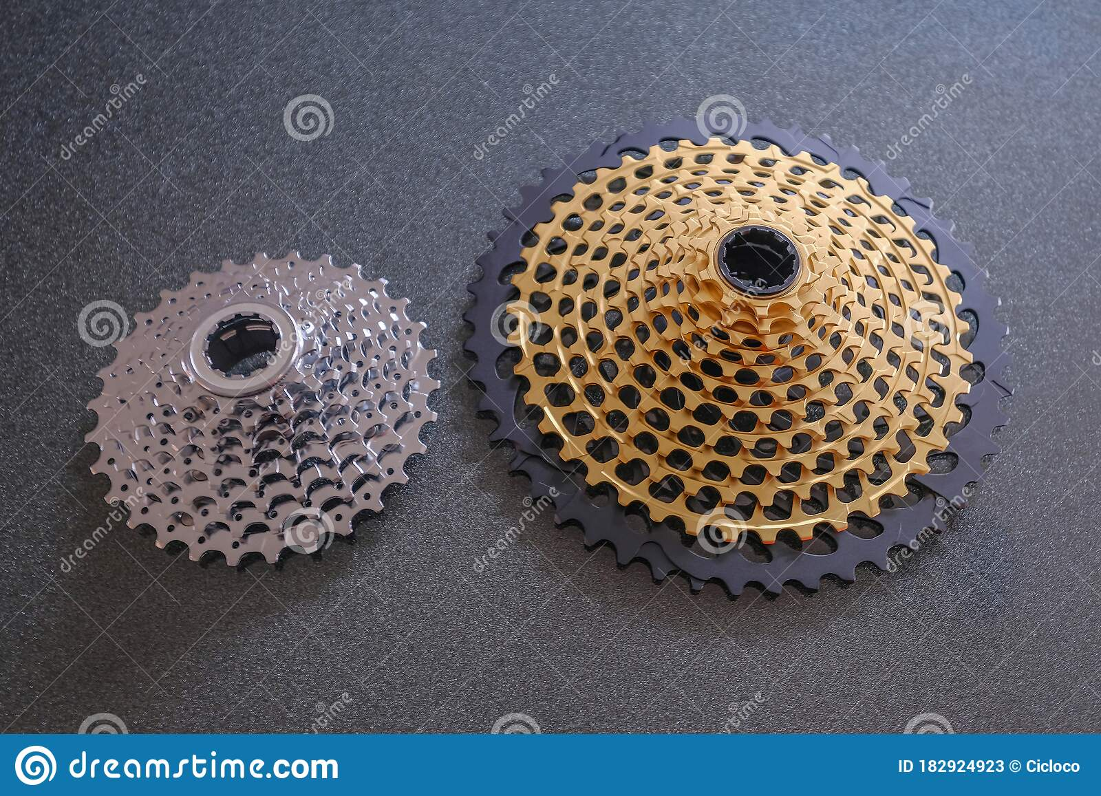 Rear Mountain Bike Cassette, Size Comparison 12-speed Vs 8-speed, Small And  Big, In Silver And Golden Color Stock Image - Image of compare, mountain:  182924923