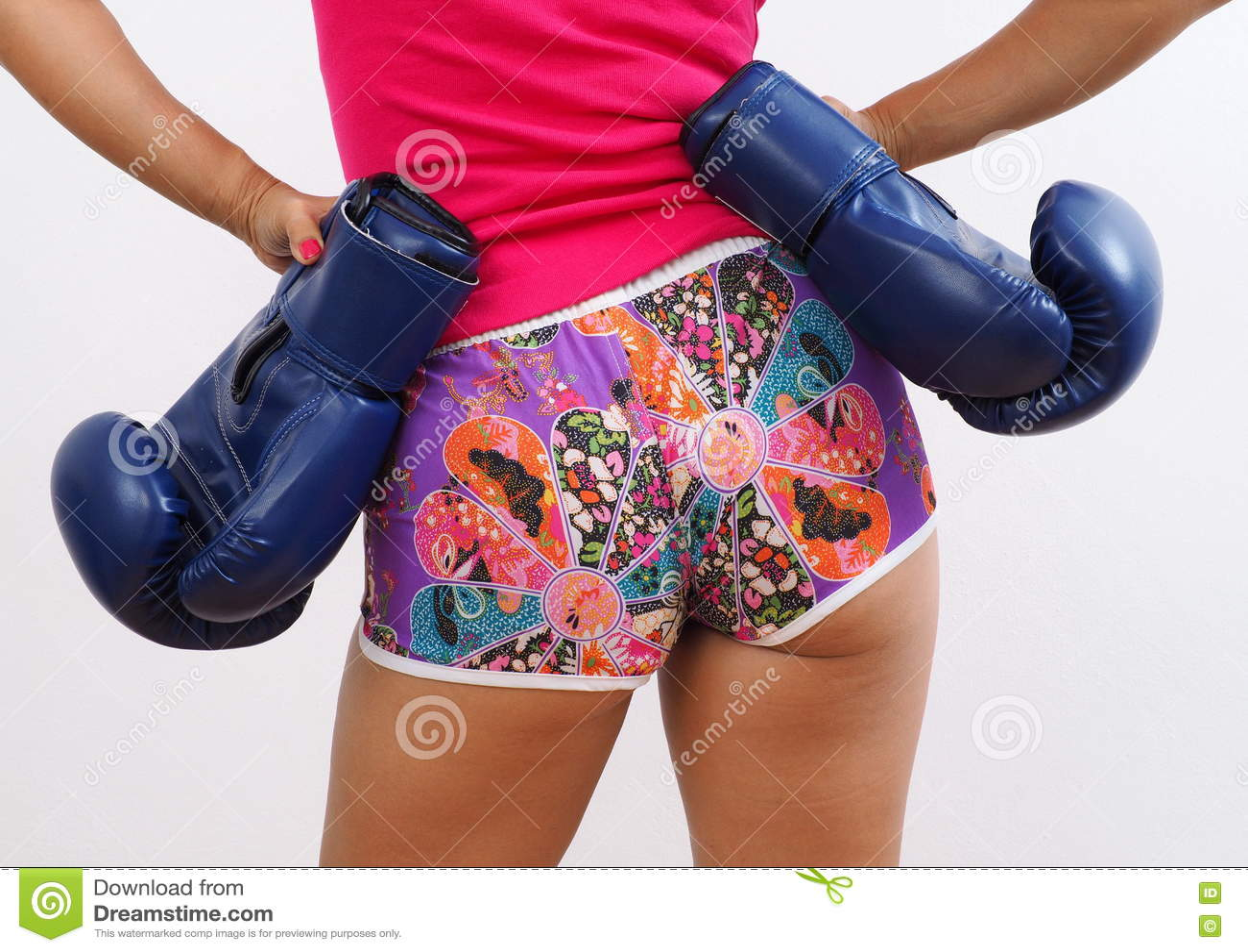 Rear shot of pretty woman wearing blue boxing gloves