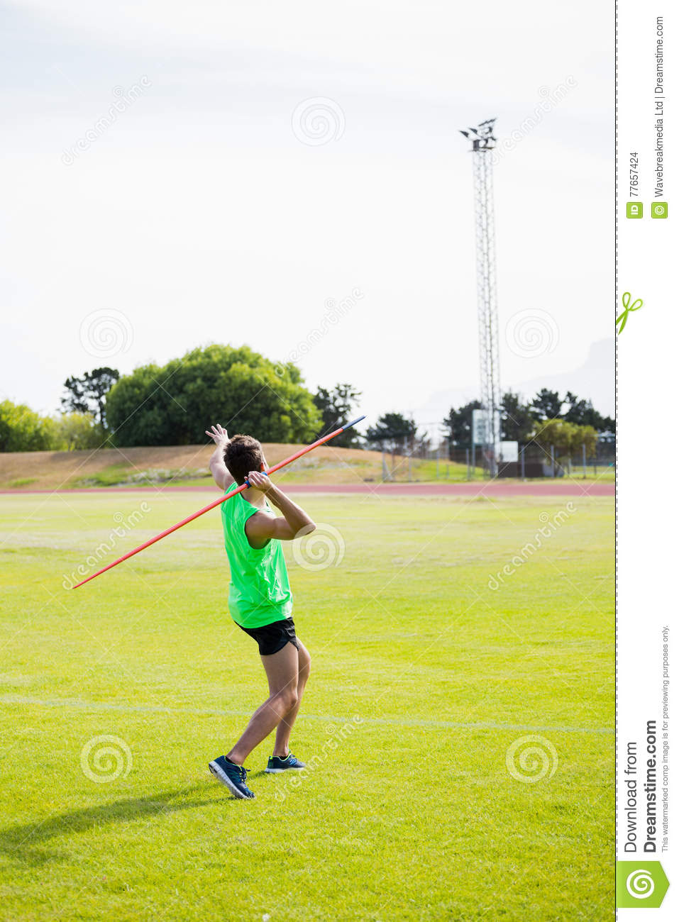 Rear view of an athlete about to throw a javelin