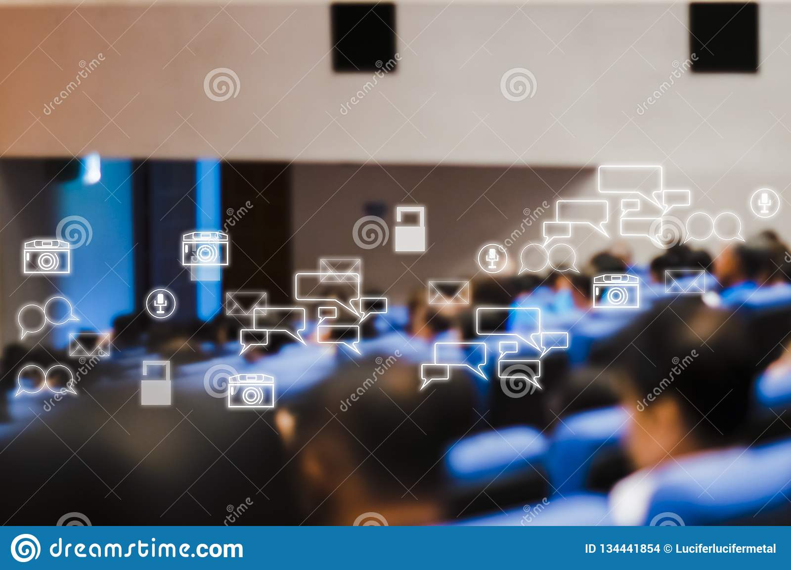 Rear view of audience attending meeting business seminar in conference room With Social Icons