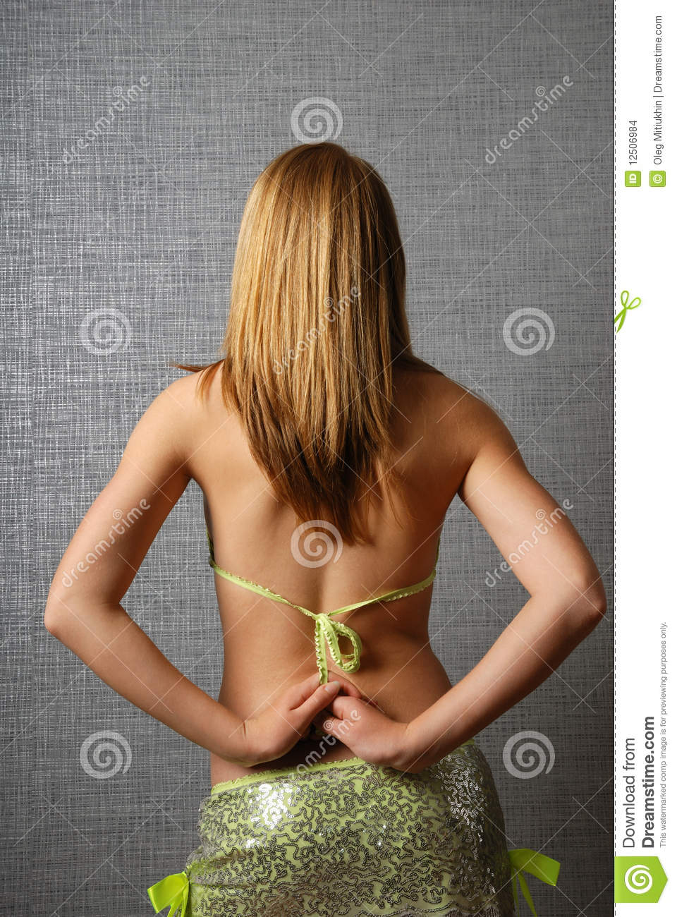 rear view of blonde undressing stock photo - image of maidenly
