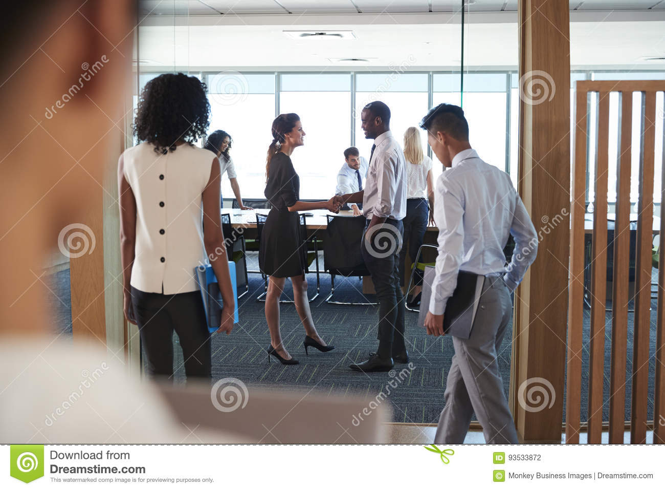 Rear View Of Businesspeople Entering Boardroom For Meeting