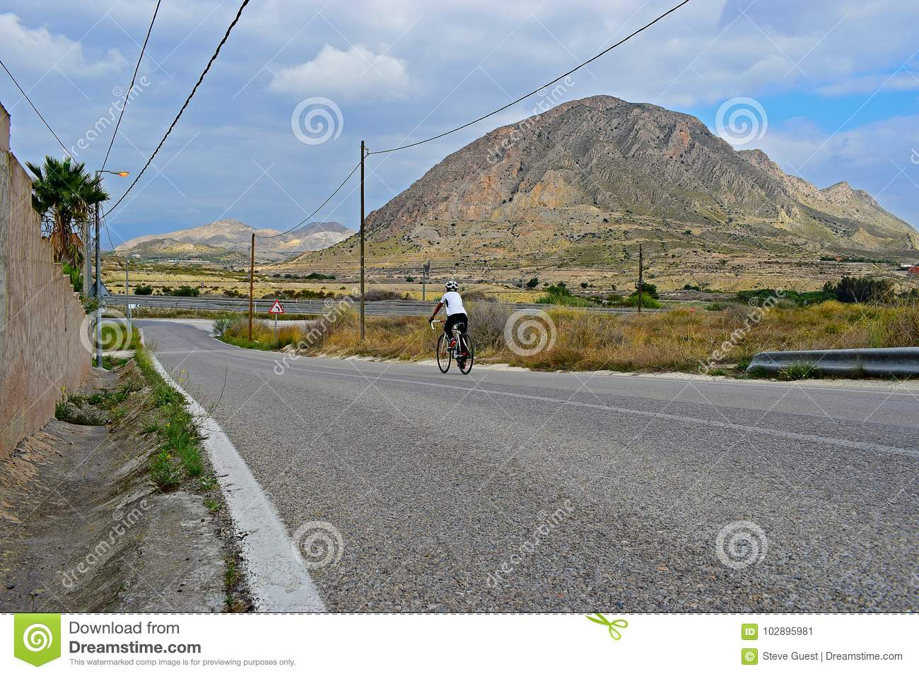 Rear View Of a Cyclist In The Mountains With Stunning Scenery