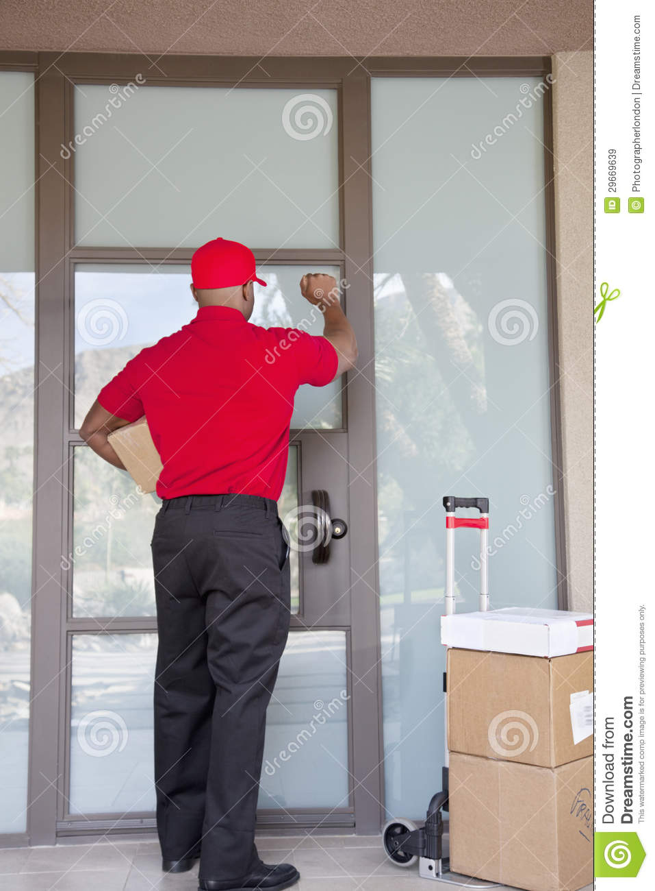 delivery door ... & Rear View Of A Delivery Man Knocking On Door Royalty Free Stock ... Pezcame.Com