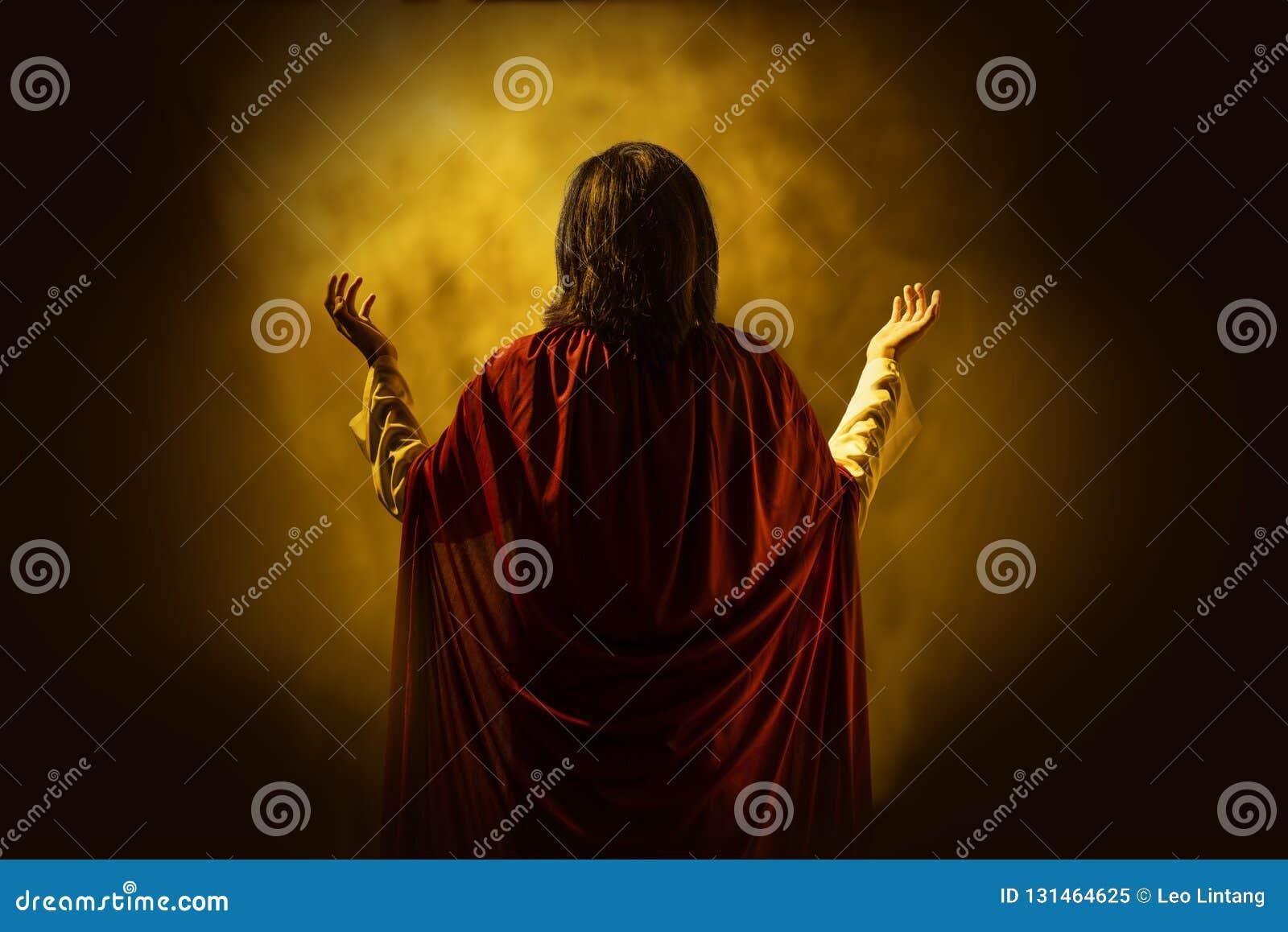 Rear view of Jesus christ praying to god