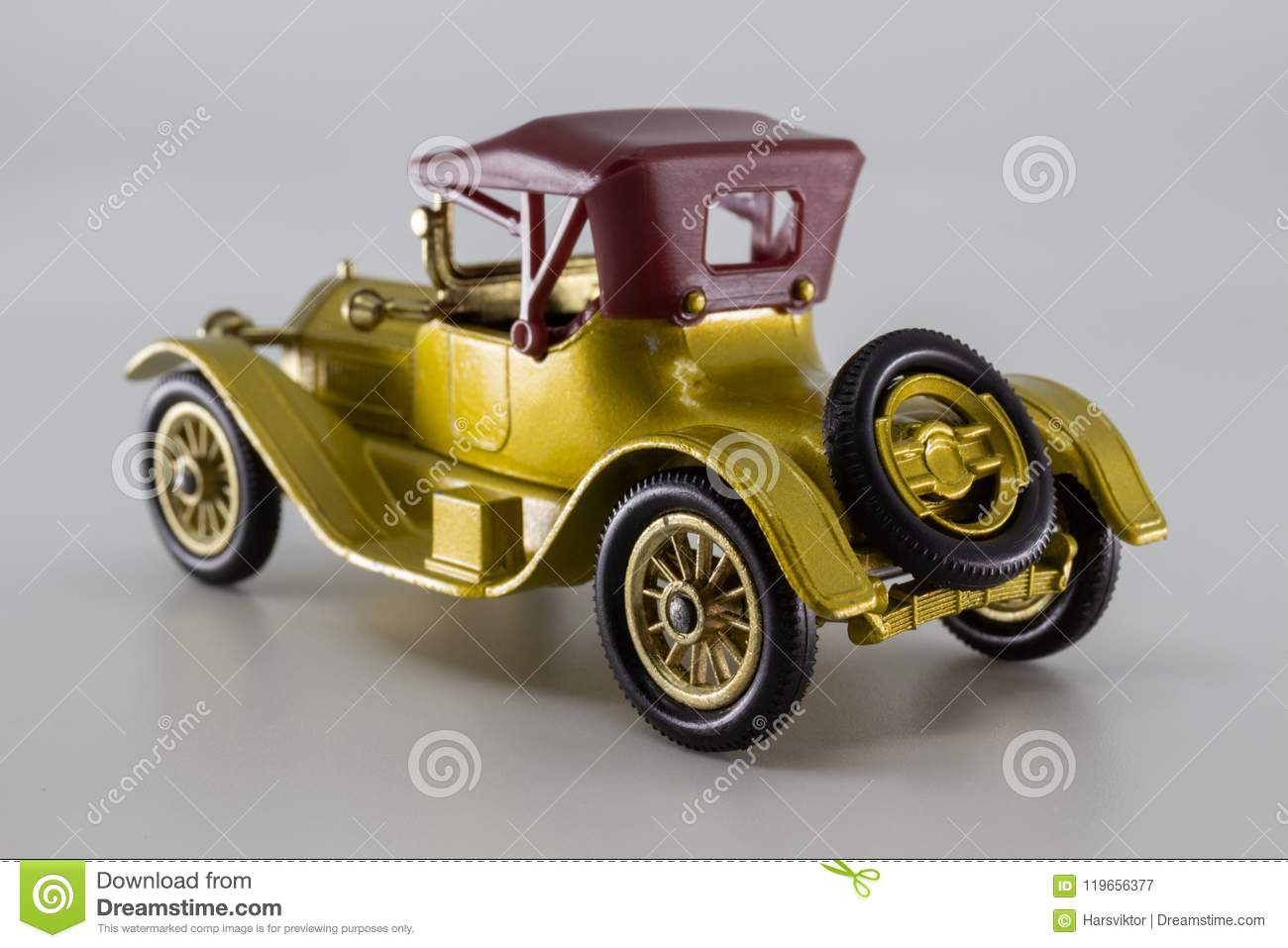 Gold Color British Toy Car 1913 Cadillac Rear View Stock Image