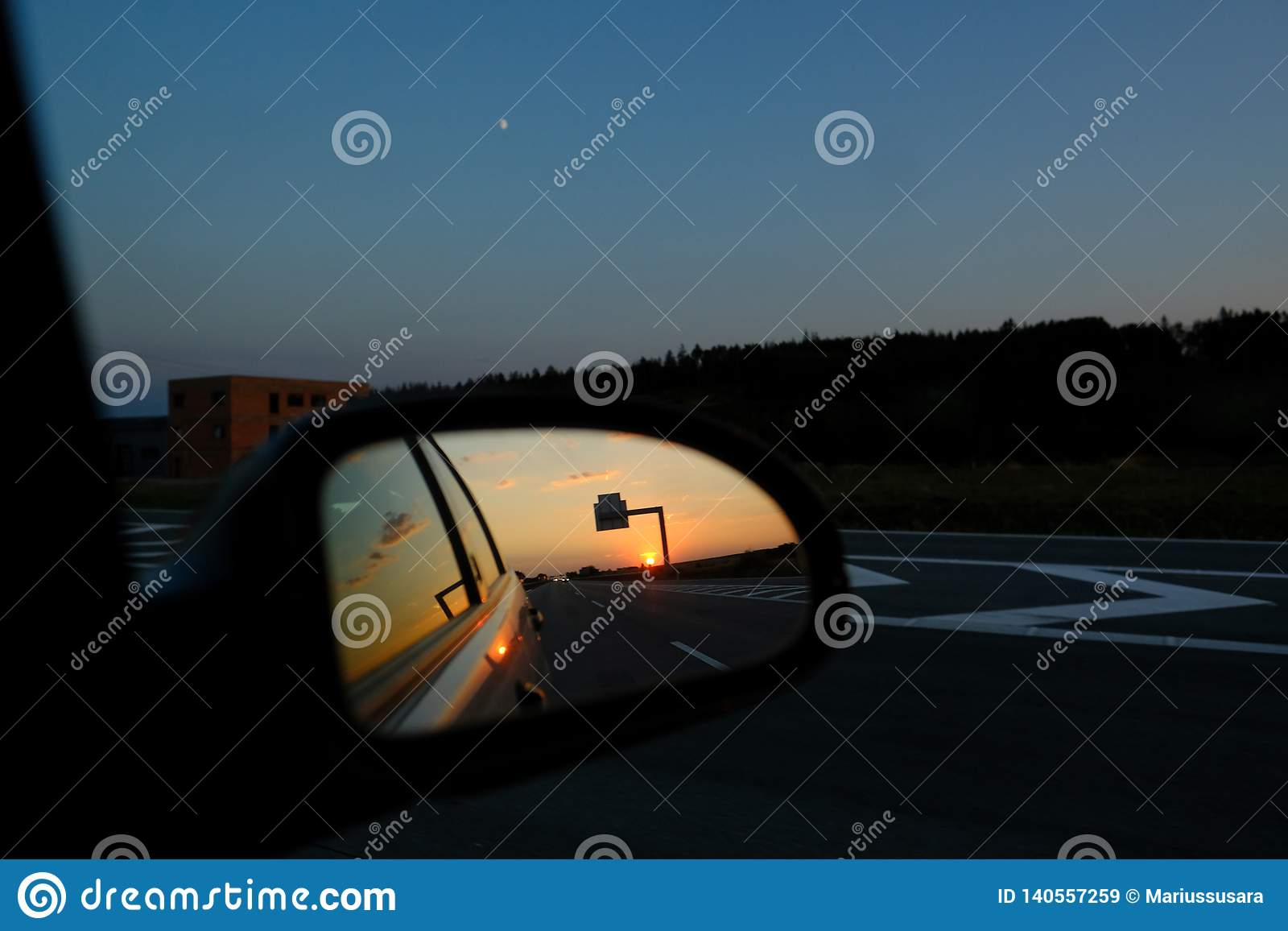Rear view mirror sunset on the autobahn