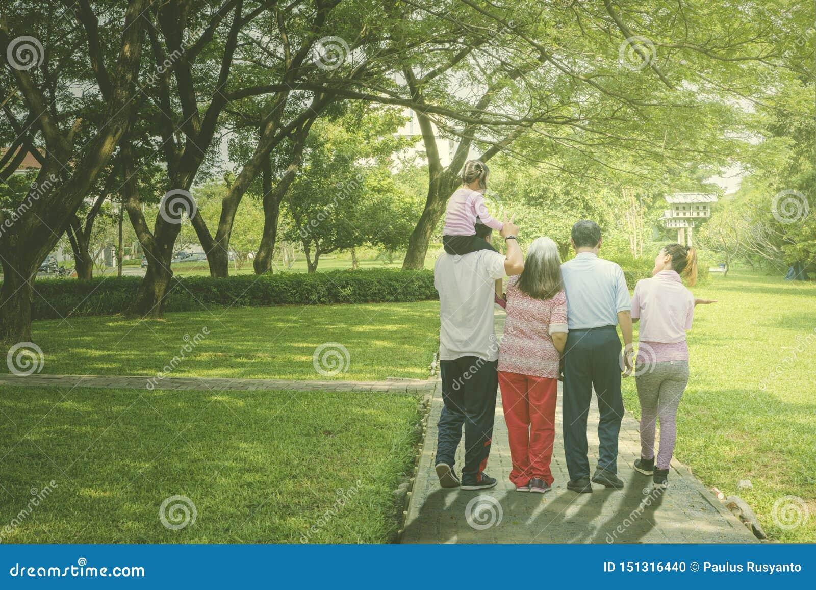 Multi generation family walks in the park