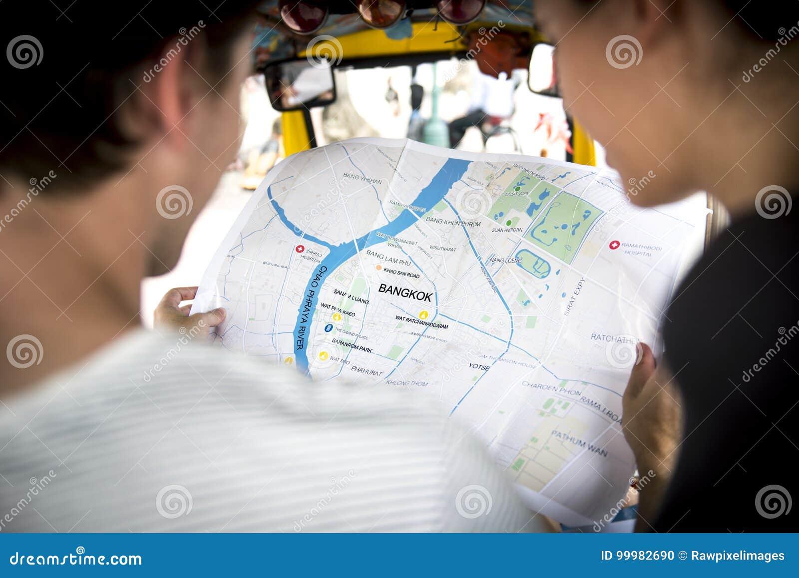 Rear view of people checking using Bangkok Thailand map