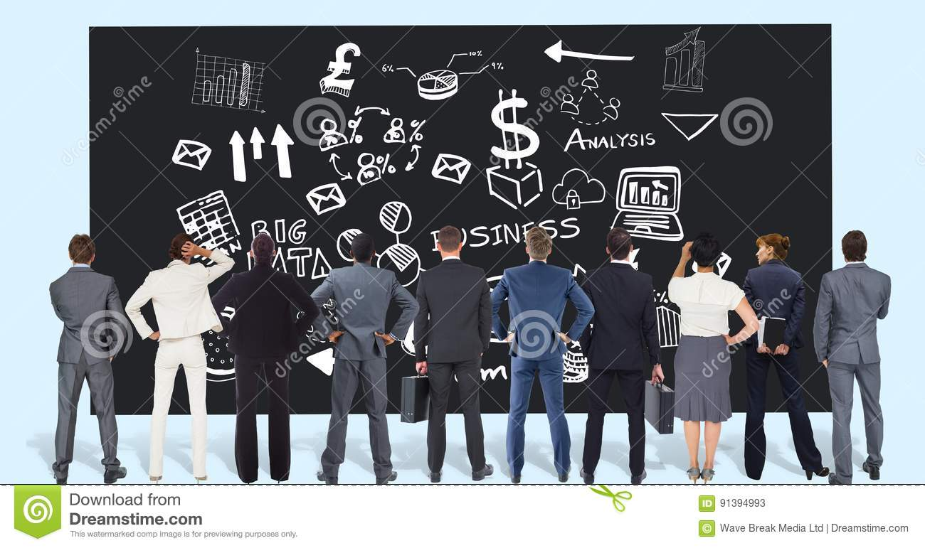 Rear view of professionals looking at business graphics on black board