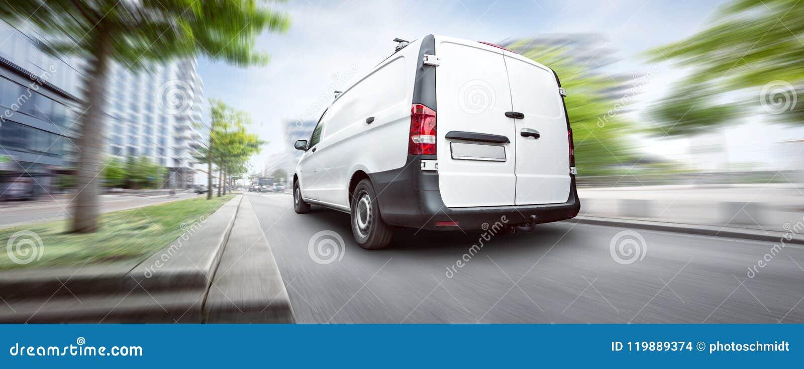 Commercial van driving in the city