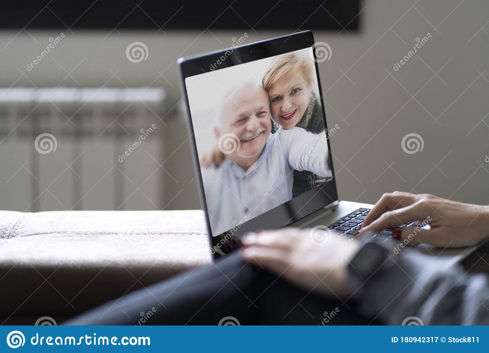Rear View Of A Woman Talking On A Family Video Call With ...