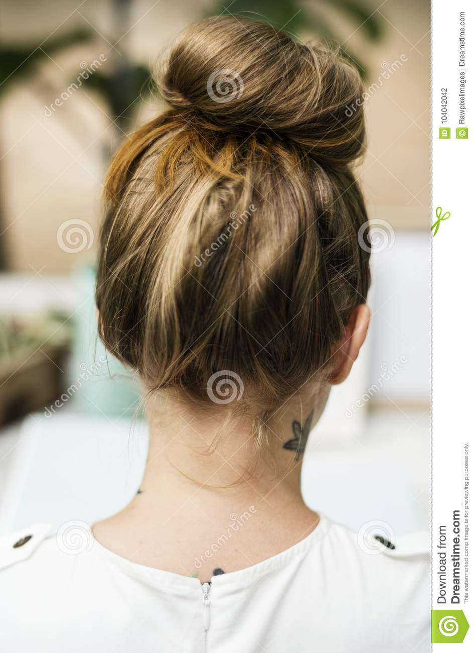Rear view of woman with tattoo at her neck