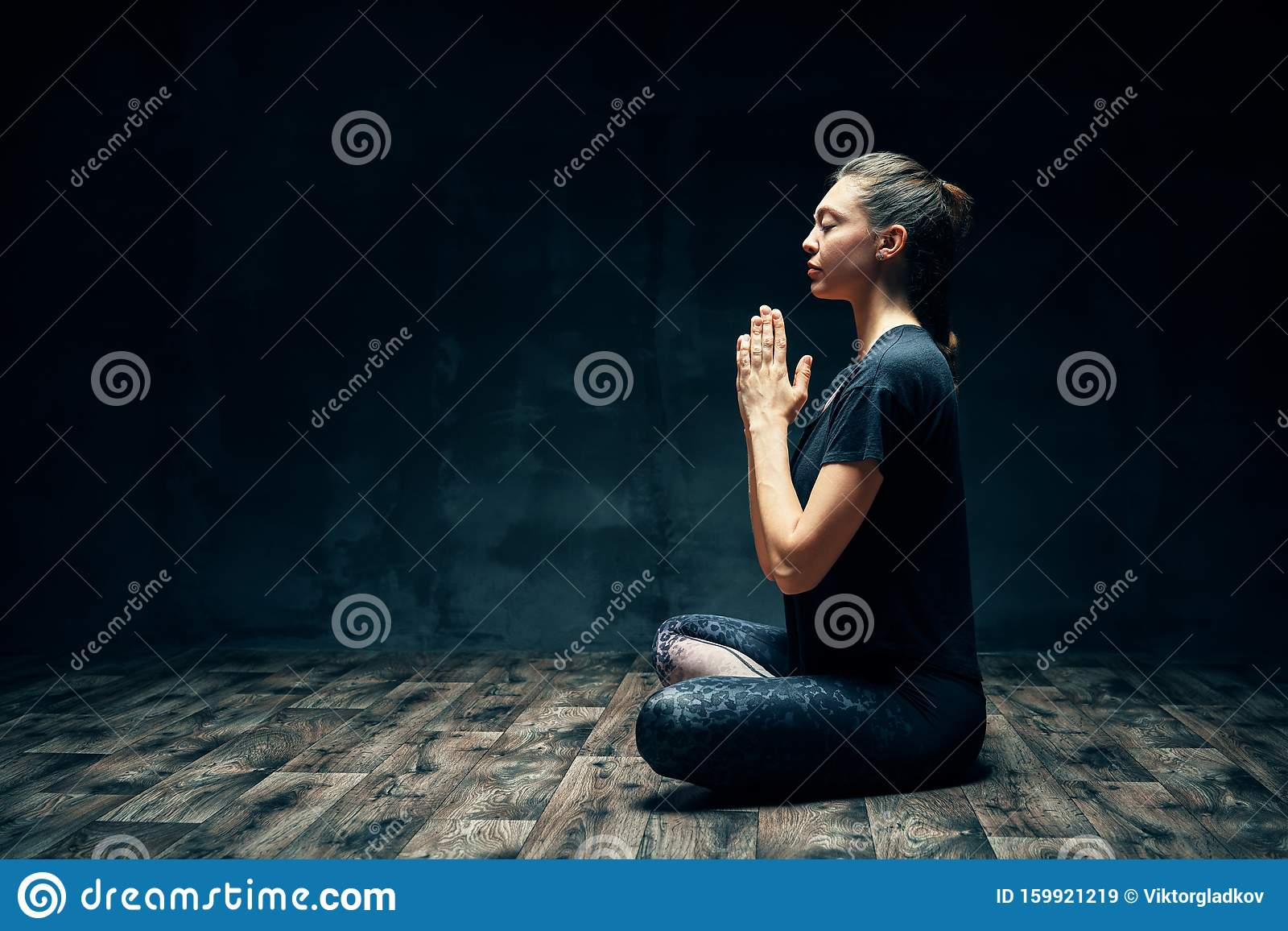 Young Woman Sitting In Lotus Position Eyes Closed Side