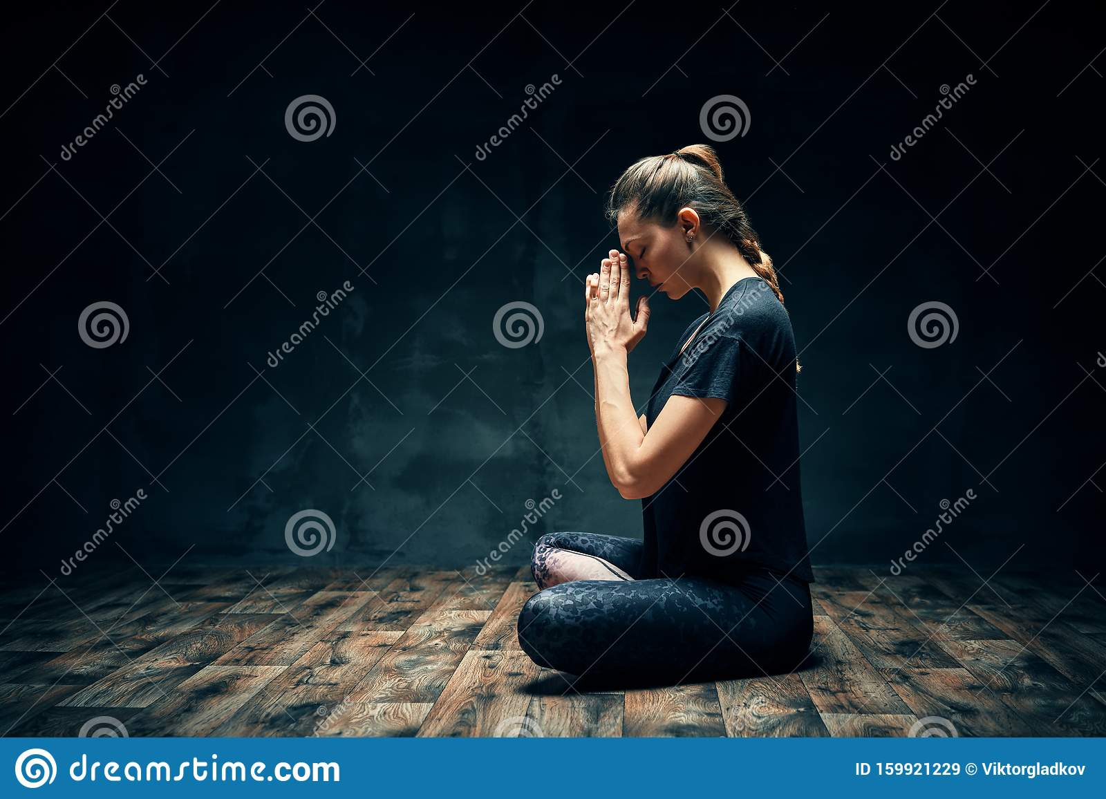 Rear View of Meditative Young Woman Sitting in Lotus Pose