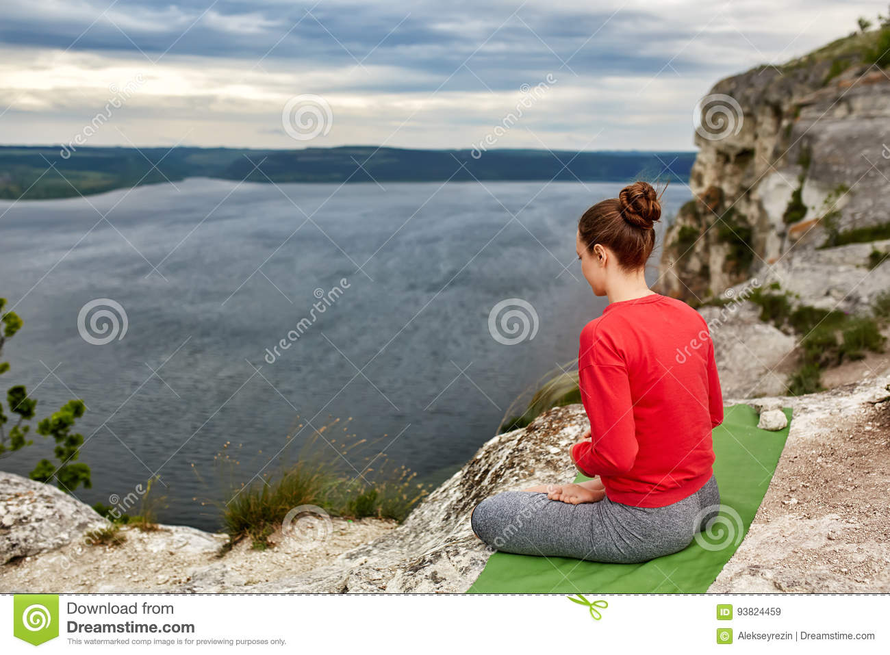 Nude woman sitting in lotus position, eyes closed Stock
