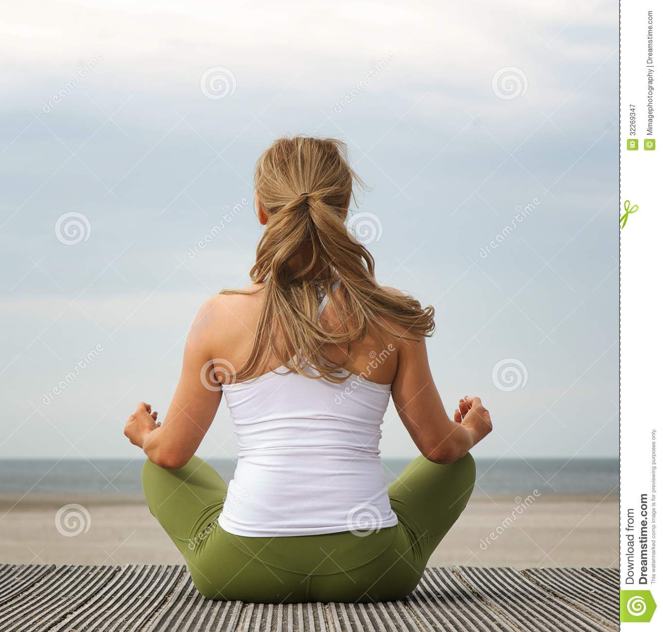 WOman Practicing Yoga At Home Stock Image - Image of