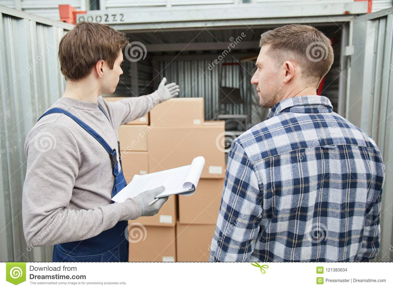 Worker showing container to client