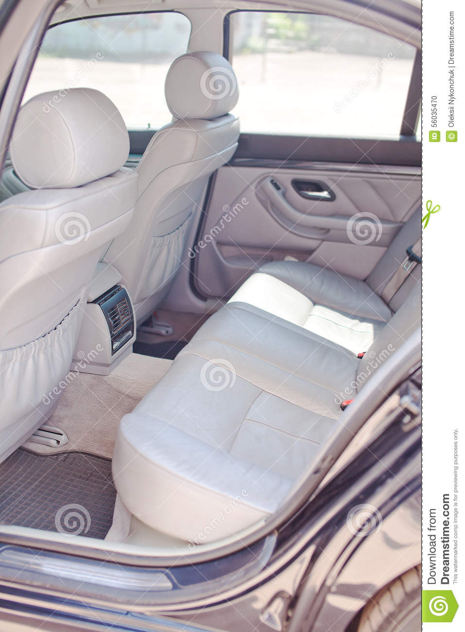 The rear white leather seats of car