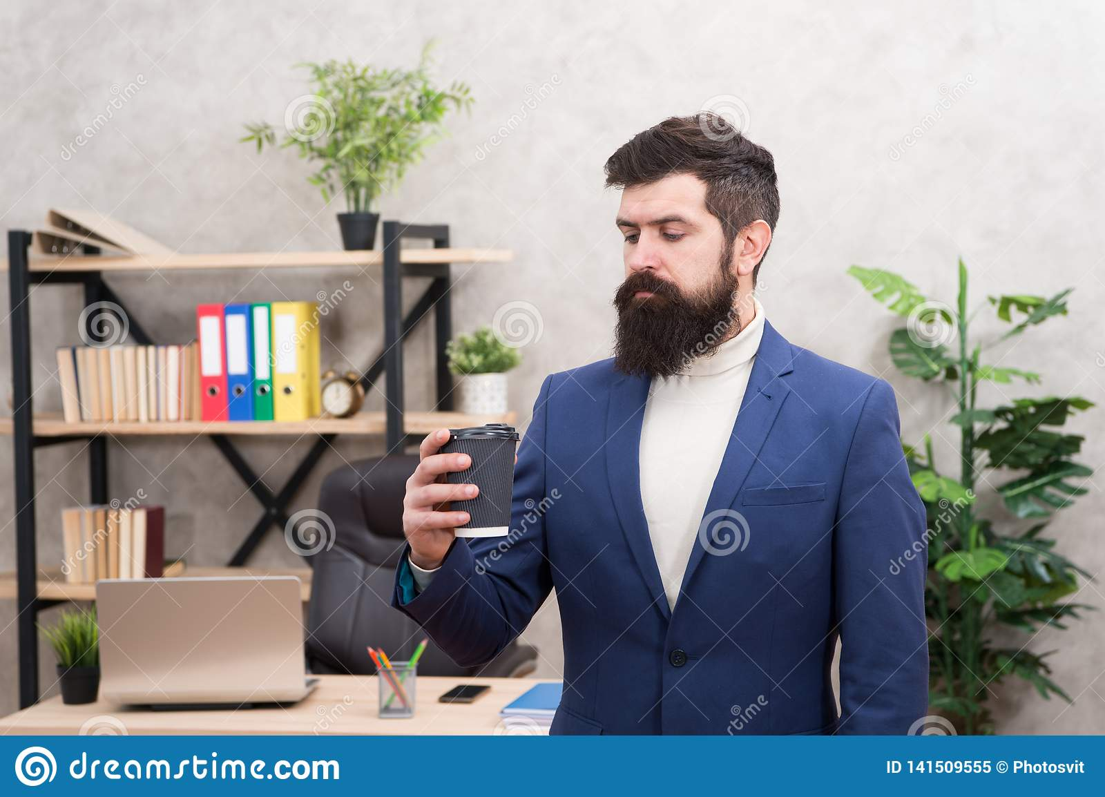 Reasons coffee improves office culture. Man bearded manager businessman entrepreneur hold cup of coffee. Relaxed manager
