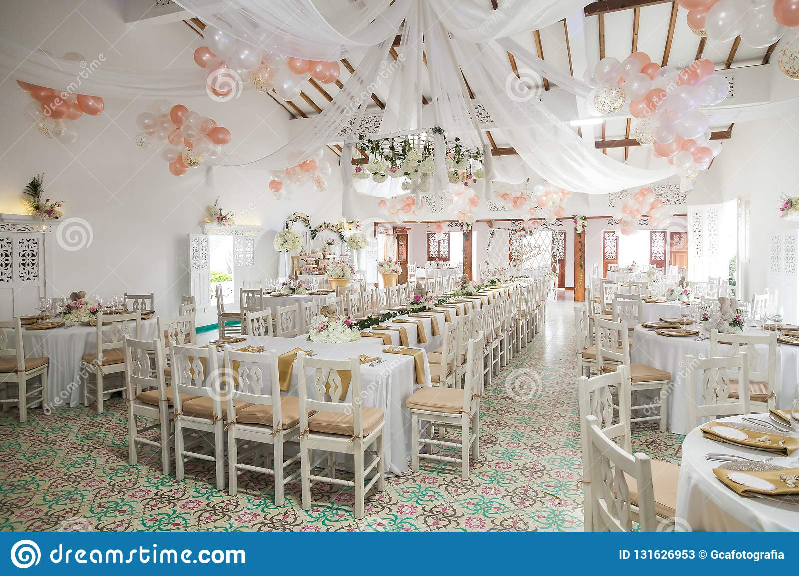 Reception Room Decorated With Tables And Chairs For The Party Stock
