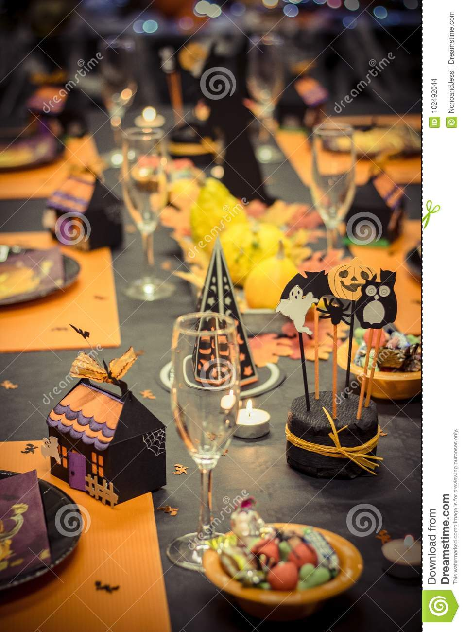 reception table with halloween party decoration, glasses and candy