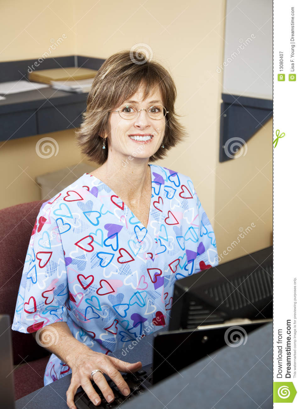 receptionist in doctors office stock image