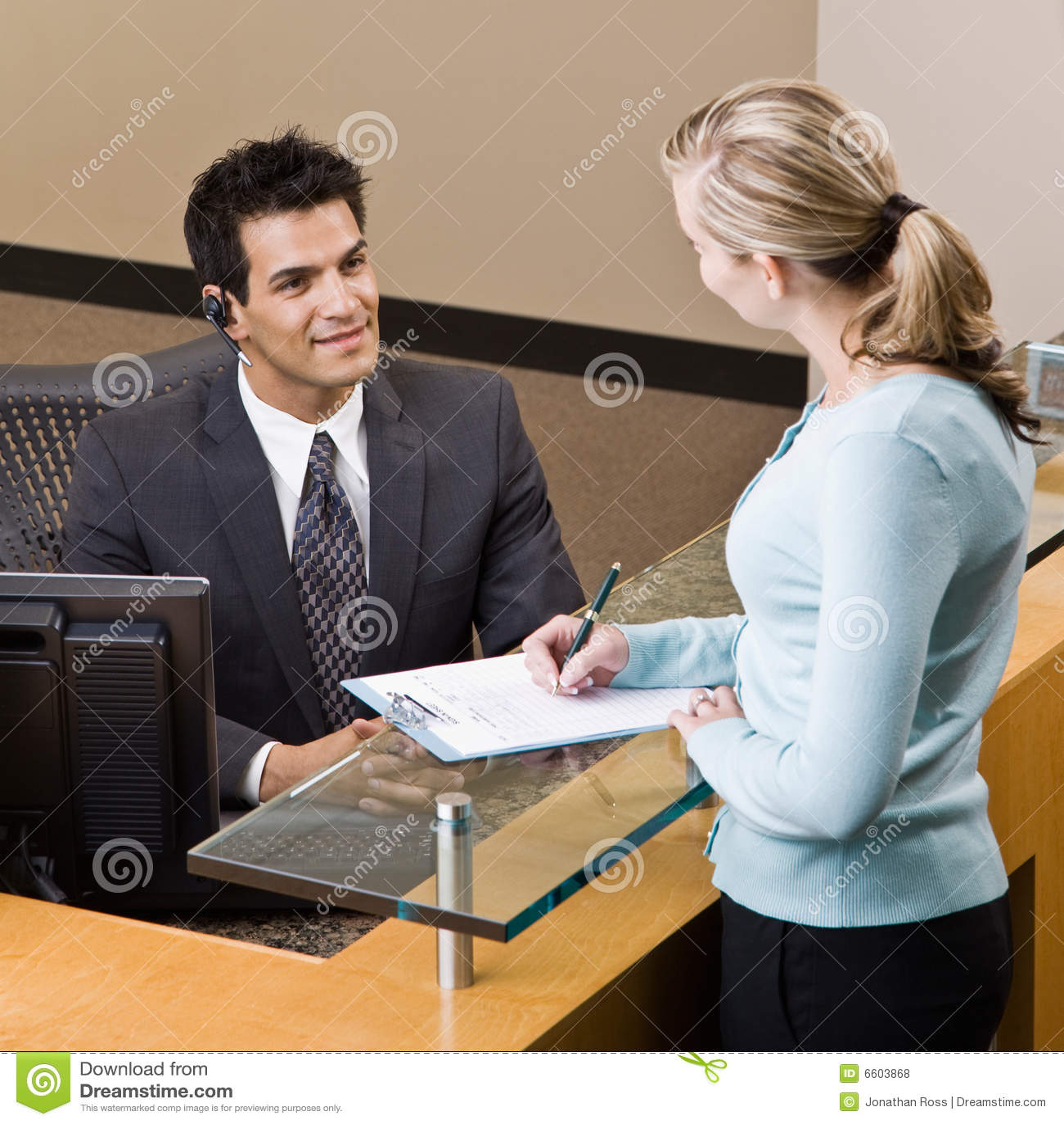 Receptionist Greeting Woman At Front Desk Stock Photo Image Of Rh  Dreamstime Com Massage Front Desk