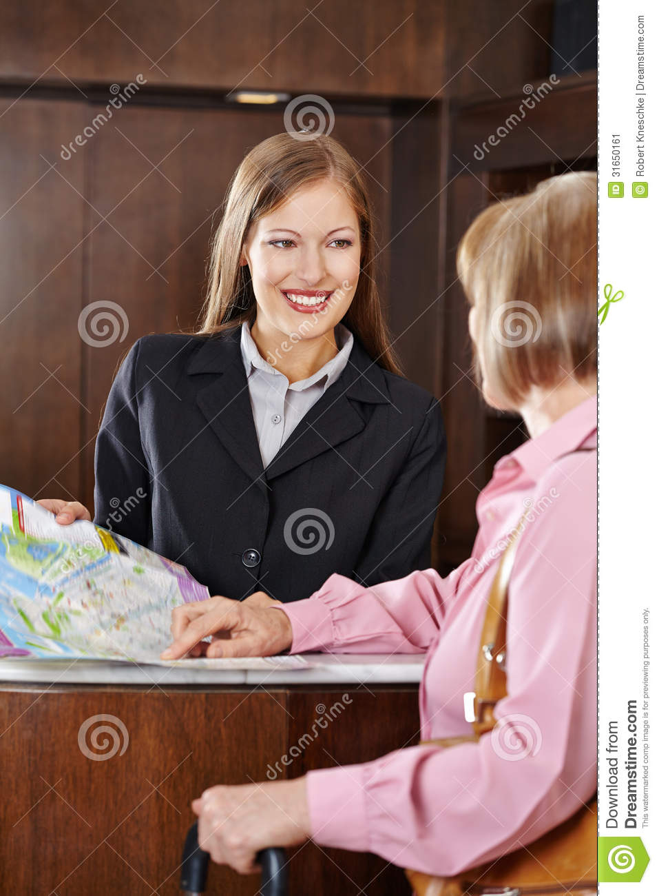 Receptionist In Hotel Offering City Map Stock Image ...