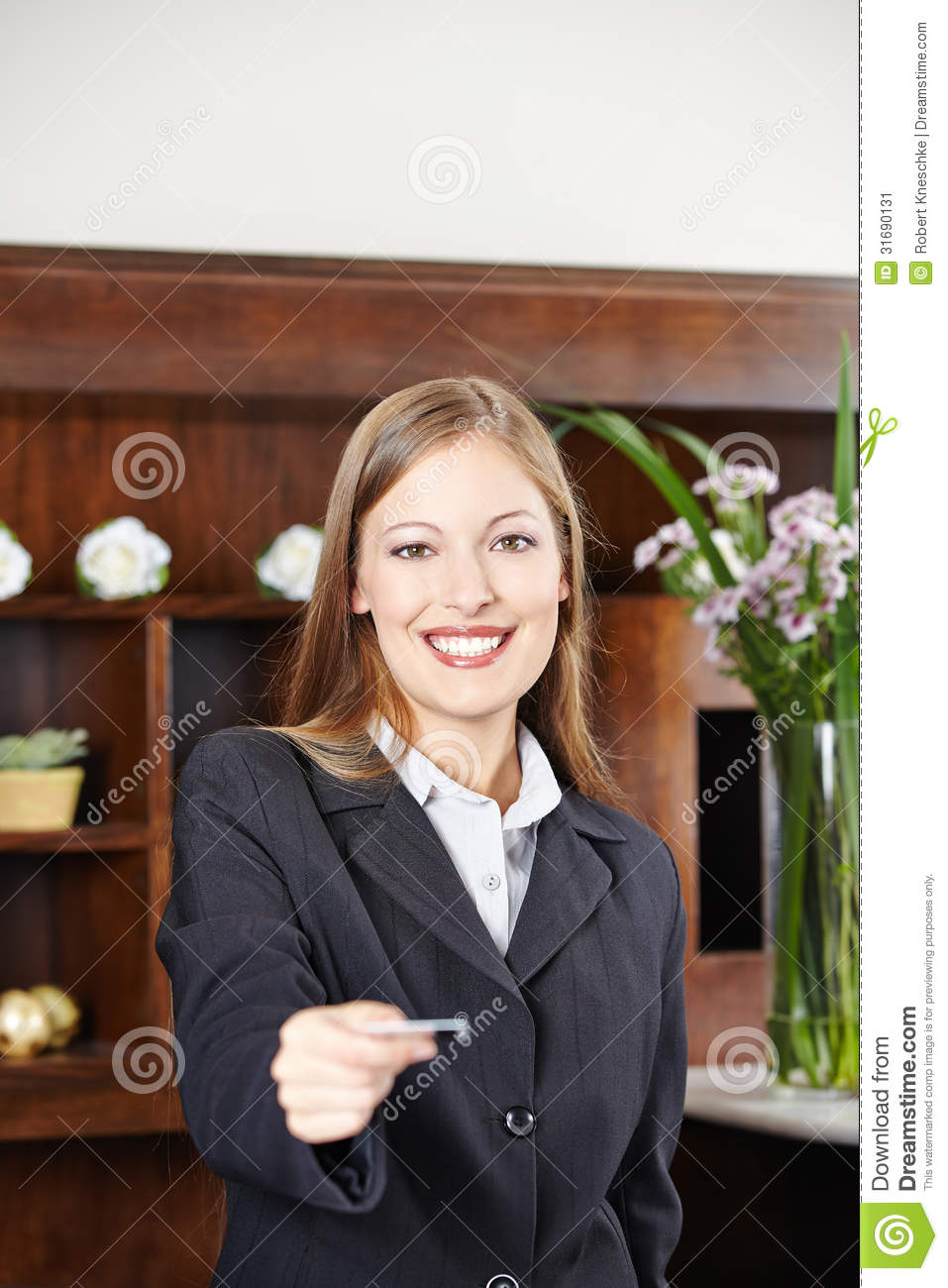 Receptionist At Hotel Offering Key Card Stock Image ...