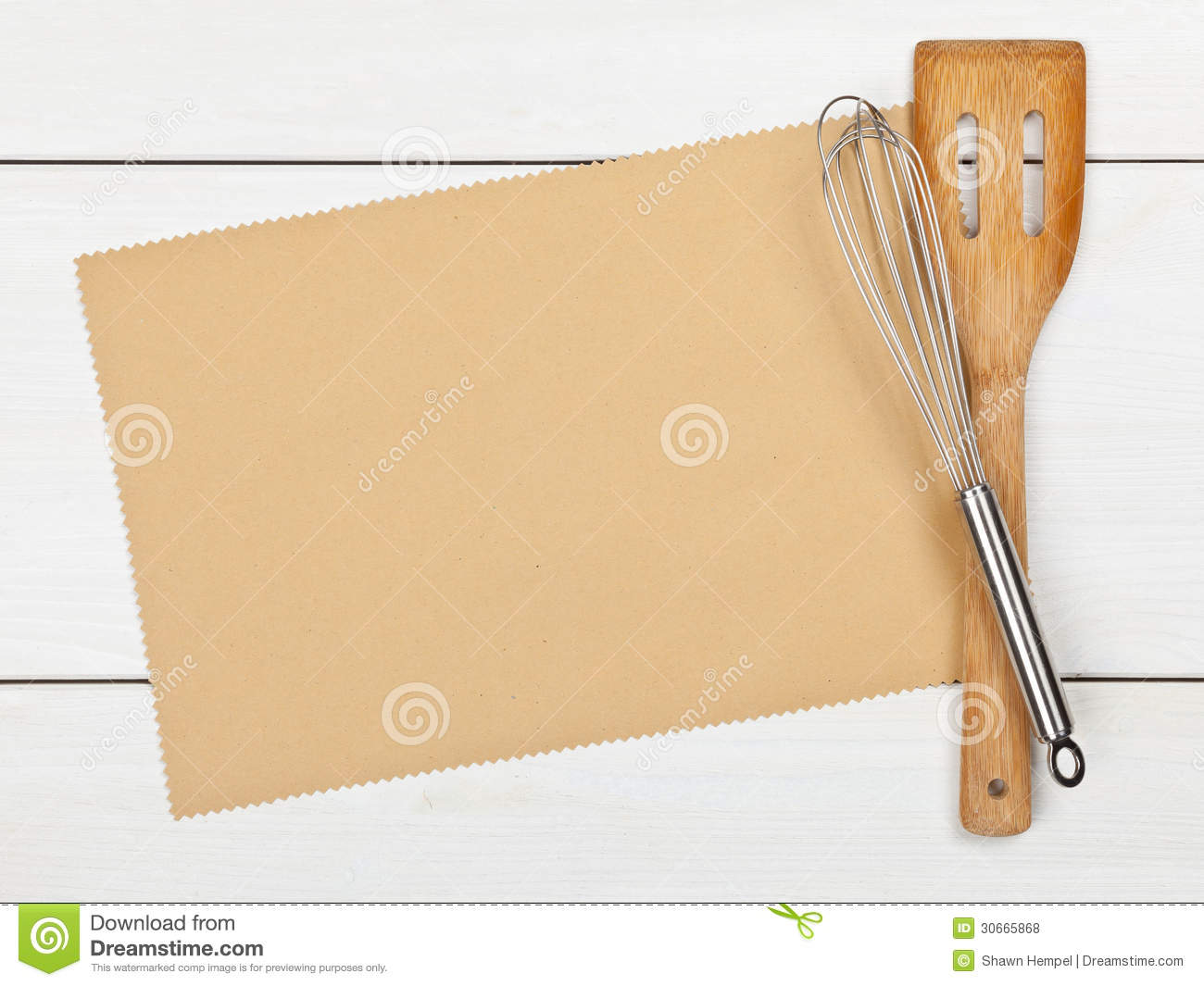 Empty paper for recipe with cooking utensils on kitchen table.