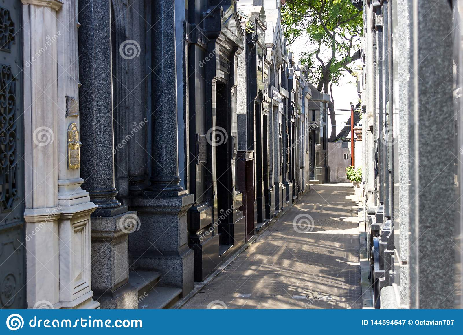Recoleta cemetery in Buenos Aires narrow passage with shadow