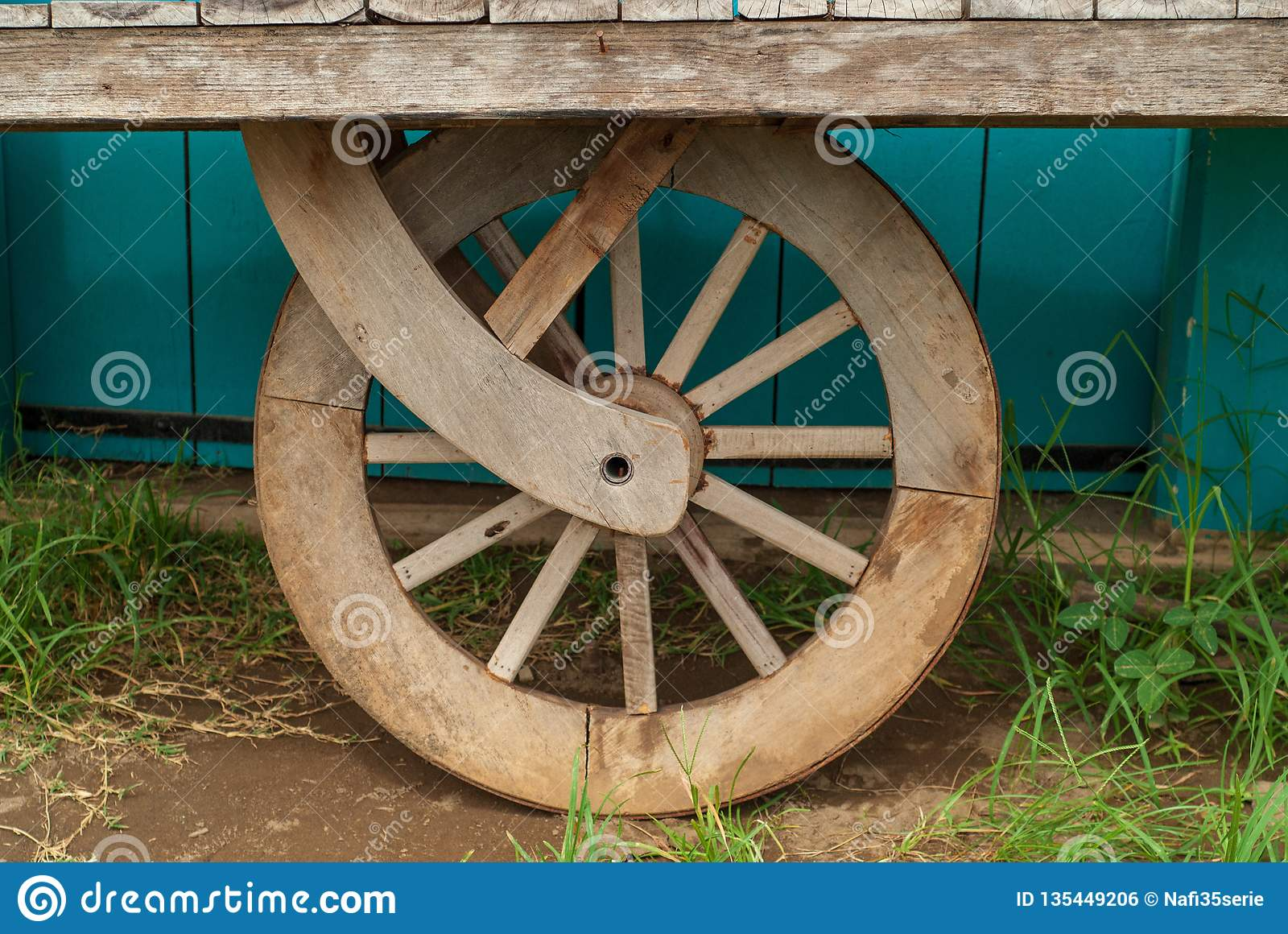 The shape of a wooden wheel on an ancient cart