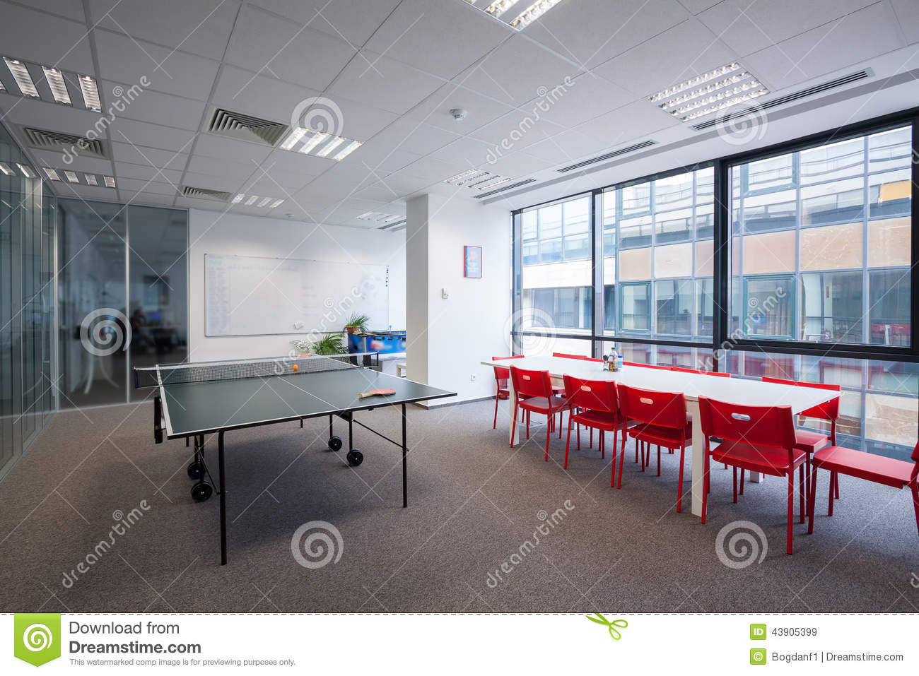 Office Room With Table, Chairs And Ping Pong Table