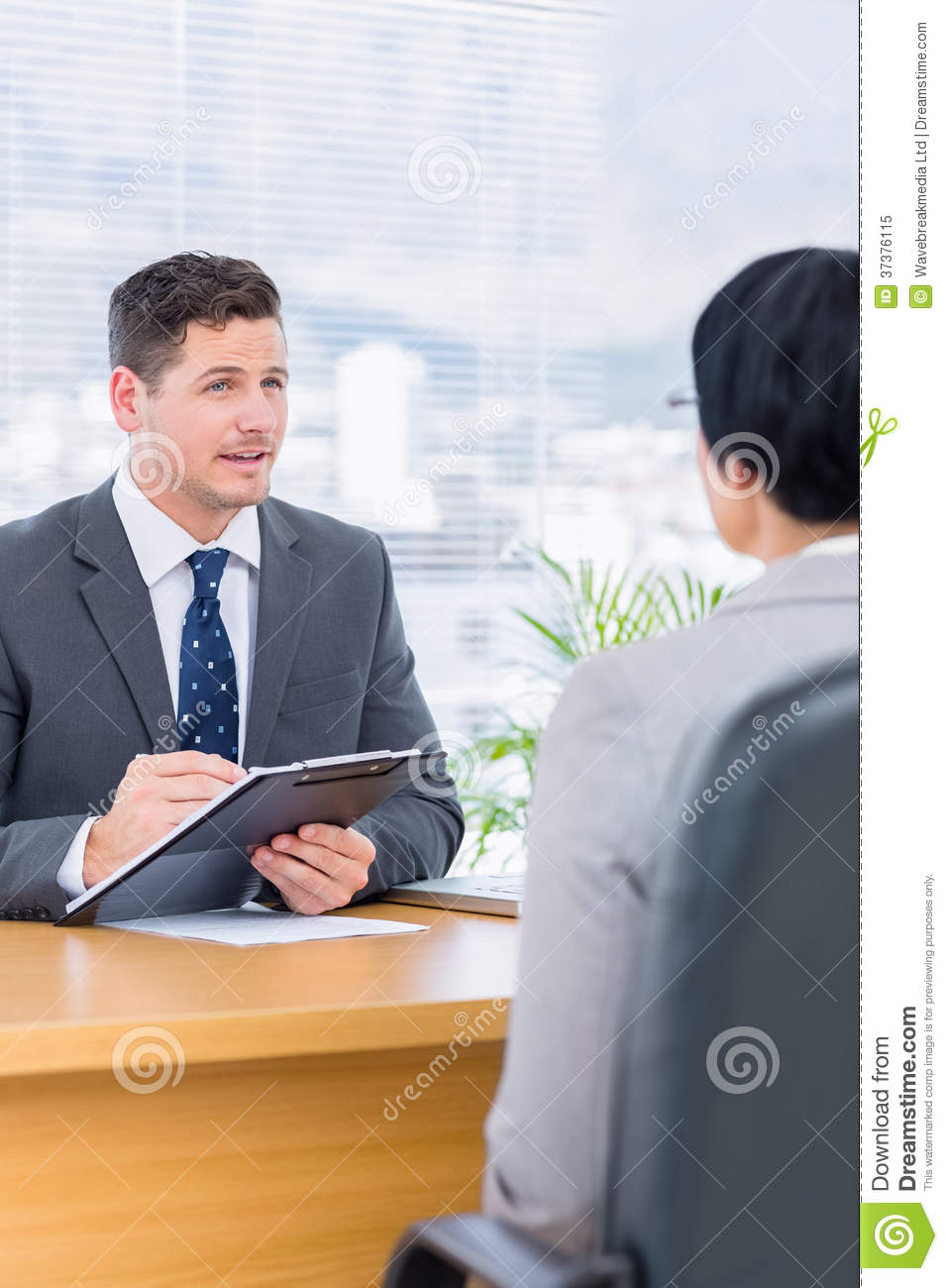 recruiter checking the candidate during a job interview royalty recruiter checking the candidate during a job interview