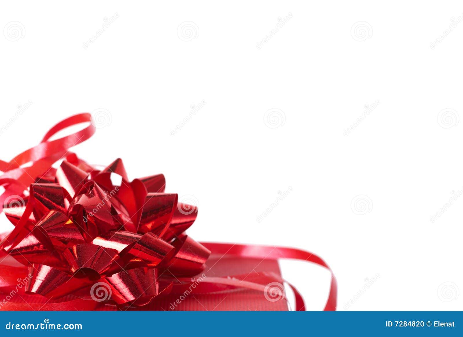 Rectángulo de regalo rojo con los arqueamientos en blanco